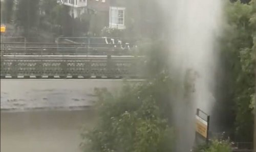 London floodwater explodes into sky as torrential rain causes Geyser-like eruption