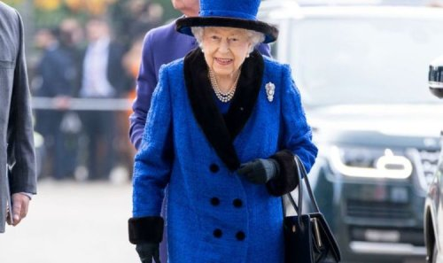 Beaming Queen in royal blue ditches her walking stick for Champions Day at Ascot