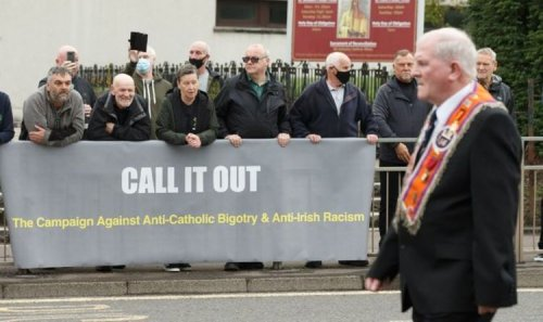 Furious row as thousands of Orange Order protesters take to streets –huge police crackdown