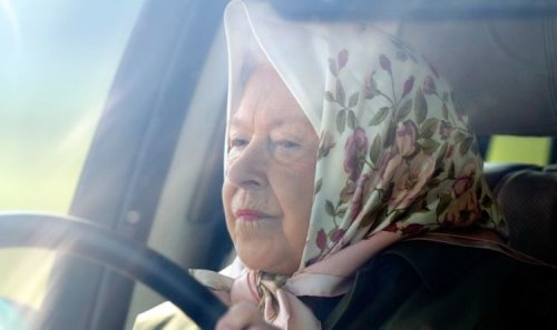 Queen cuts lonely figure as she's spotted driving to take loved dogs for walk on birthday
