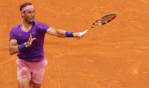Rafael Nadal reacts to beating Novak Djokovic in Italian Open final