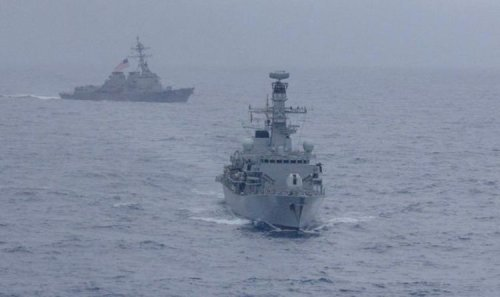 Bellicose China warns Royal Navy taskforce to keep out of its 'waters'