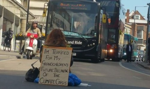 Drivers furious as Green Party councillor joins sit down road block protest