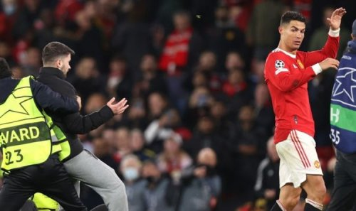 Pitch invader charges towards Cristiano Ronaldo and stopped by security after Man Utd win