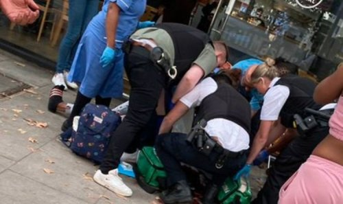 London stabbing panic: Terrified crowd gasps at blood spattered road after daylight attack