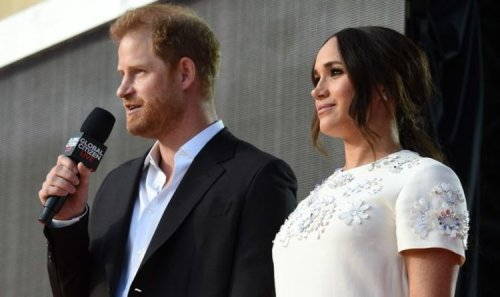 Meghan Markle and Prince Harry hold hands as they take to stage at concert in New York