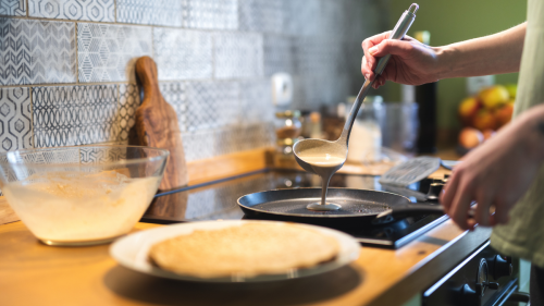 This Hack Makes Flipping Food in a Frying Pan So Much Easier