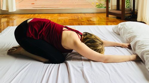 10 Bed Yoga Poses to Ease Pain and Have the Best Sleep of Your Life