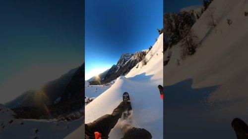 Snowboarder rides down epic mountain line