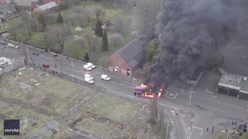 Drone Footage Captures Bus in Flames Following Belfast Riot