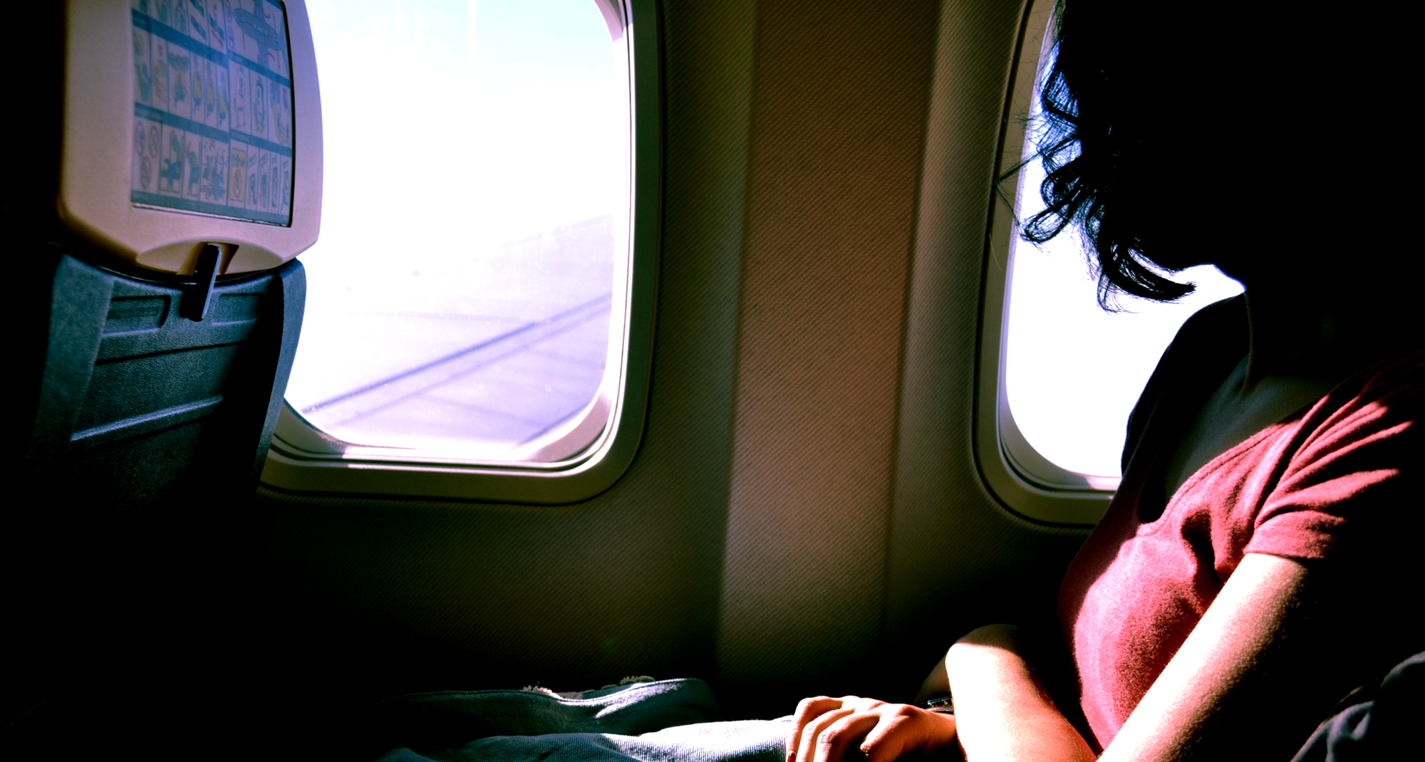 The gross reason you should never put your head on an airplane window