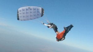 Must See! This is the Jaw-Dropping Moment a Skydiver Surfs on a Human Surfboard Midair