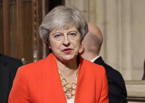 Theresa May rebukes Boris Johnson as UK welcomes Biden era