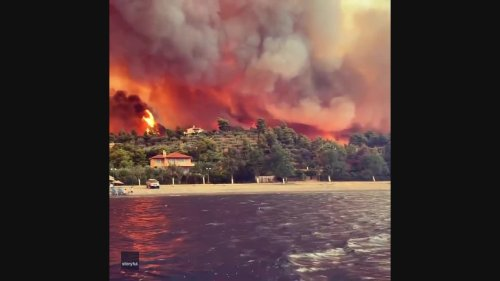 Wall of Flame Rises Behind Greek Beach as Wildfires Spread
