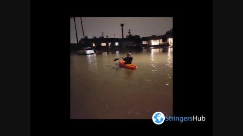 US: Arizona Resident Kayaks Down Flooded Street After Storm Hits Phoenix Metro