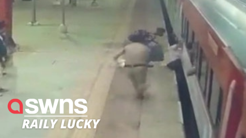 Railway cop rushes to save a passenger from being crushed under moving train in New Delhi, India