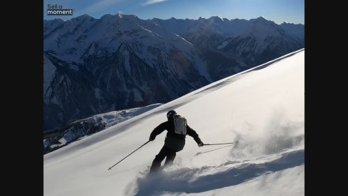 Athlete skis down fresh snow in slowmotion