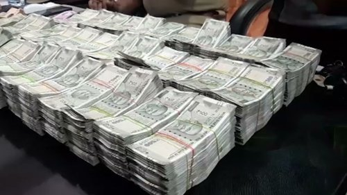 Police officials seize $1,88,550 in southern India