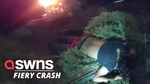 Heroic cops pull an unconscious passenger out of a flaming car