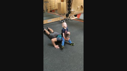 Kid Helps With Weight in Dad's Workout