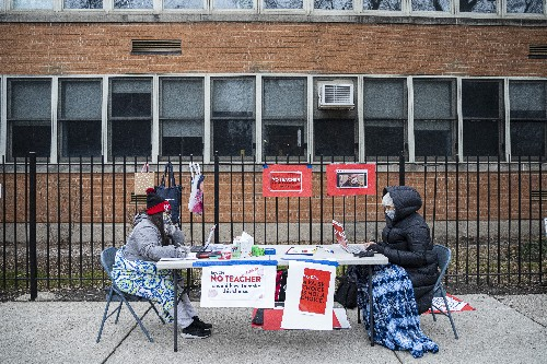 Chicago teachers vote to teach from home, defying district