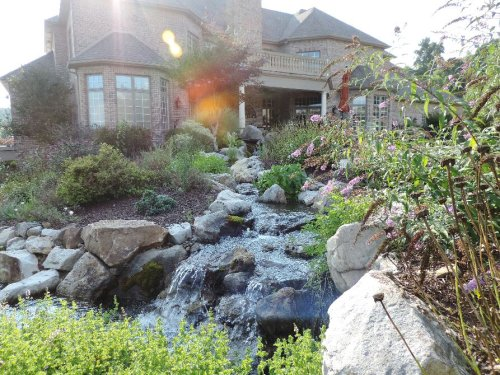 Beautiful Pond With Large Stream And Waterfall cover image