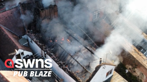 Dramatic drone footage shows a grade-II listed building and pub in flames