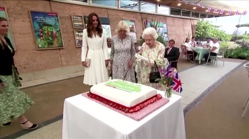 Queen cuts cake with sword at G7 event