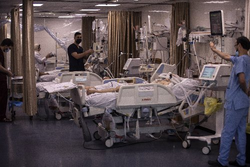 Beset by virus, Gaza's hospitals now struggle with wounded