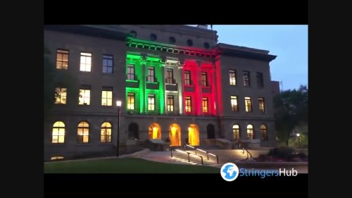 The McDougall Center in Calgary, Canada illuminated with the colors of the Mexican flag on Mexico's