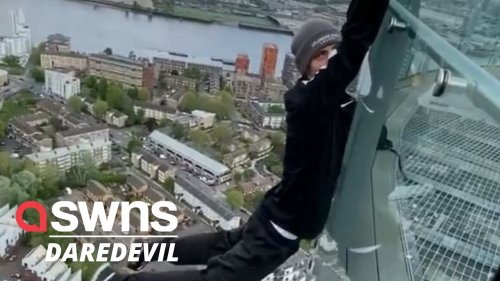 Foolhardy daredevil hung from a London skyscraper with his fingertips (RAW)