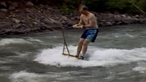 Surfer Don Catches Some Waves on a River in Wyoming