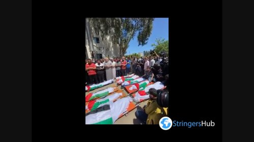 Funeral ceremony in a ruined city of Gaza