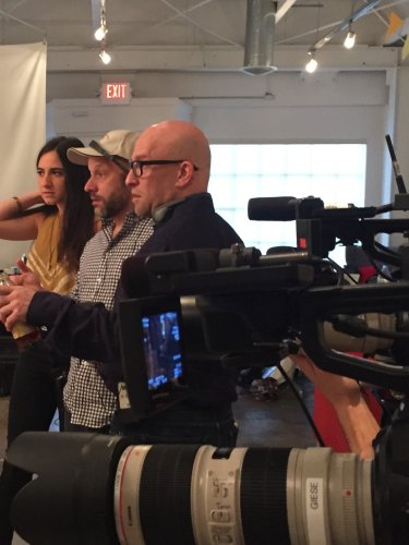 Co-creator Michal Zebede and producers Shawn Efran and Solly Granastein give direction during filming