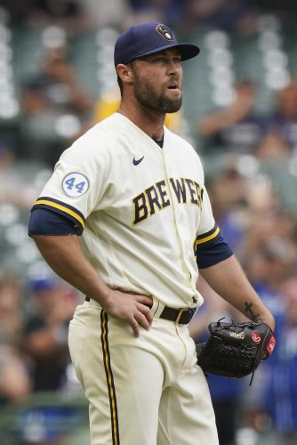 2 more Brewers positive for virus; Strickland, Cousins out