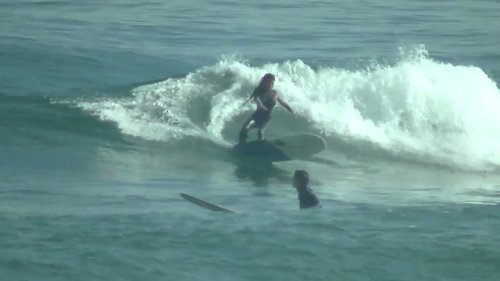 Surfer Girl Displays Impressive Talent