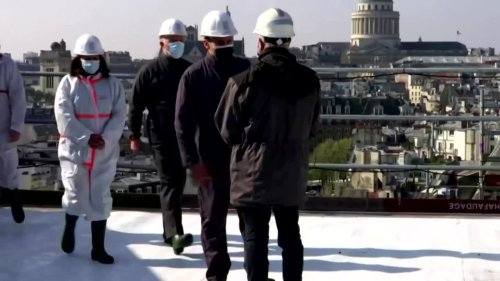 Macron scales Notre-Dame's rooftop
