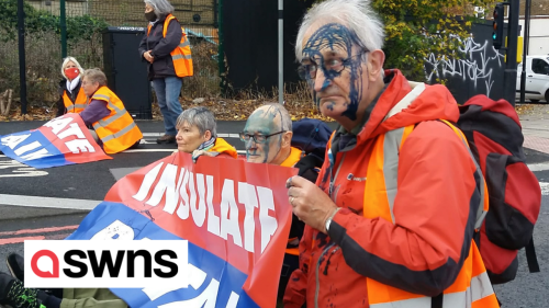 Insulate Britain protestors covered in ink by motorists as they block a London road