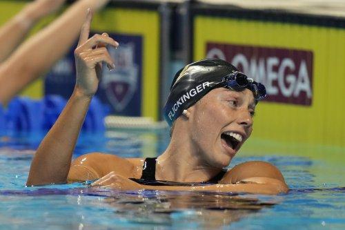 Dressel wins, but Manuel fails to advance in swim stunner
