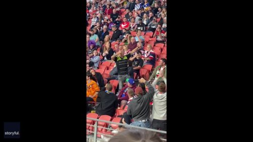 Fan Chugging From Shoe Delights Crowd at Brisbane Stadium