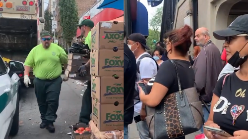 Fury as NYC sanitation workers filmed throwing pallets of fresh food into garbage truck