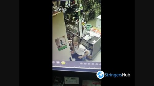 A hidden camera captured the funny moment when the employee arranged her workplace in Minsk, Belarus