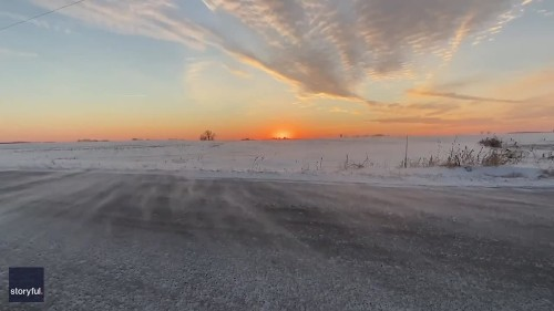 Thin Veils of Snow Blow Over Country Road During Wisconsin Sunset