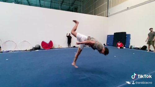 Acrobat Athlete Performs Continuous Backflips