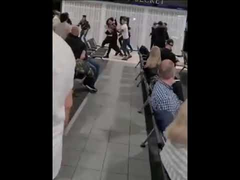 This 17-person airport fight might be the year's wildest