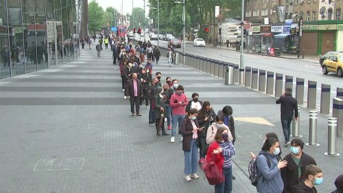 Hundreds of young people queue at Spurs stadium for vaccines