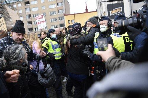 Hundreds in Stockholm protest Sweden's virus restrictions