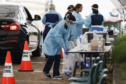 The Latest: Tenn. governor enacts new virus restrictions