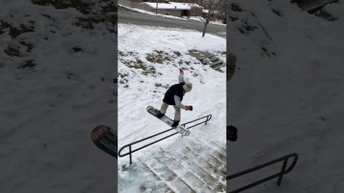 Athlete Performs Epic Boardslide Over Flight of Stairs in Slowmotion