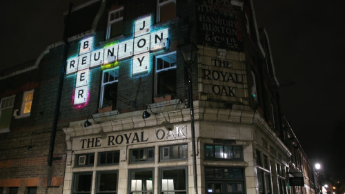 Light projections featuring uplifting words to celebrate National Scrabble Day